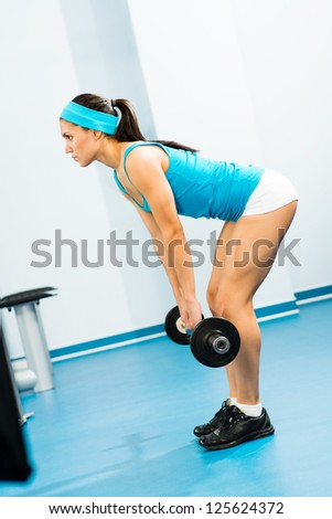 young woman doing body-building in the Gym, live a healthy life - stock photo