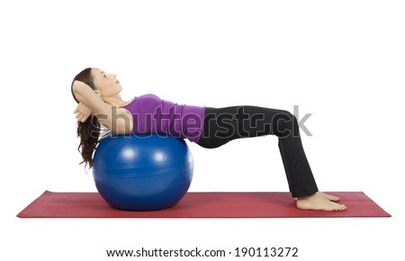 Young woman doing crunch on a pilates ball.