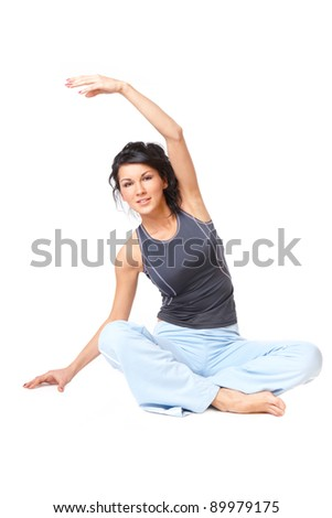 Young woman doing exercise, isolated on white background - stock photo
