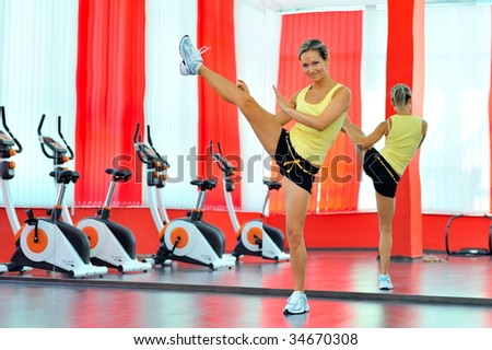 young woman doing exercises in the gym - stock photo