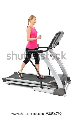 young woman doing exercises on treadmill, on white background - stock photo