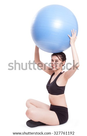 Young woman doing exercises with fitness ball.
