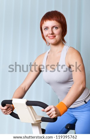 young  woman doing exercising on training apparatus