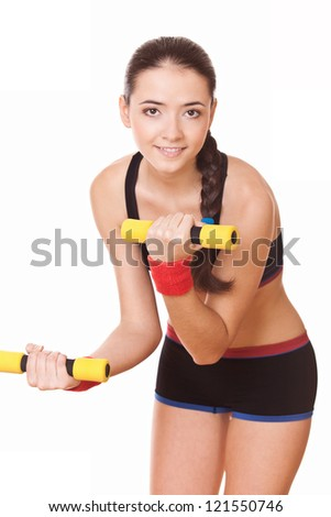 young woman doing fitness exercises with weights - stock photo
