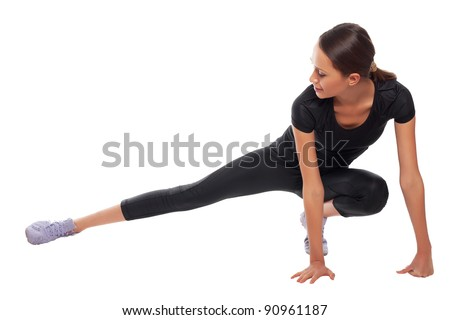 young woman doing gymnastic on a white background