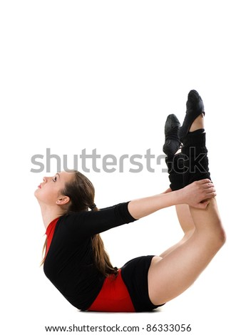 Young woman doing gymnastics against a white background