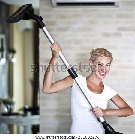 Young Woman Doing Housework  - stock photo