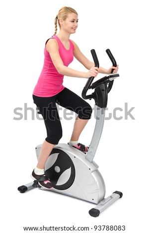 young woman doing indoor biking exercise, on white background - stock photo