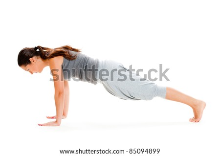young woman doing push-up exercise on floor. isolated on white background - stock photo