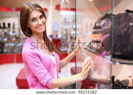 Young woman doing shopping in clothes store