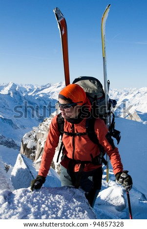 Young woman doing ski touring. Outdoor winter activity - stock photo
