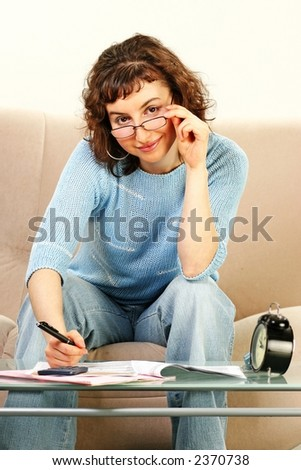 young woman doing some paperwork-filling tax form