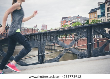 Young woman doing sport in Hamburg - stock photo