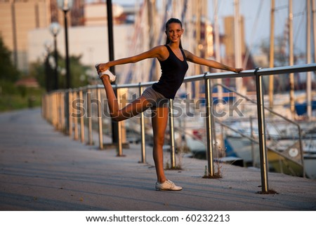 Young woman doing stretching before jogging - stock photo