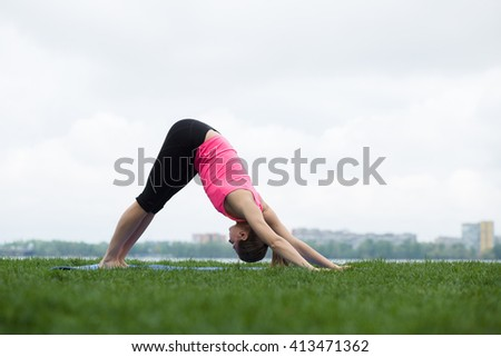 Young woman doing stretching exercises at open air