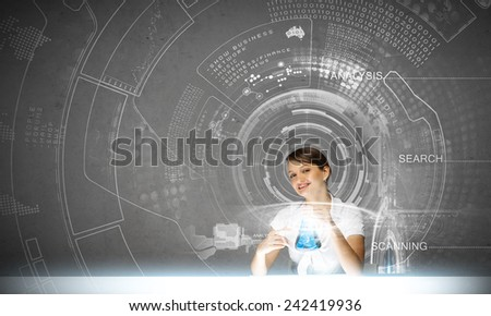 Young woman doing tests at chemistry laboratory - stock photo