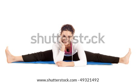young woman doing the splits on exercise mat