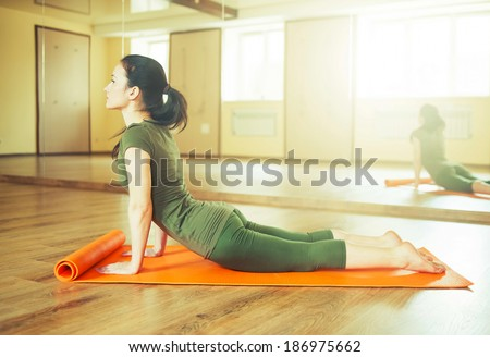 young woman doing yoga - stock photo