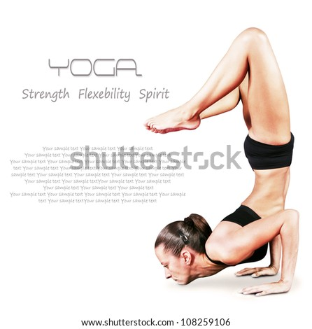 Young woman doing yoga exercise balancing on hand over white background - stock photo