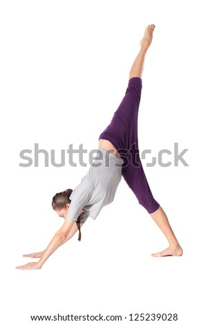 Young woman doing yoga exercise Downward-Facing Dog. Isolated on white background