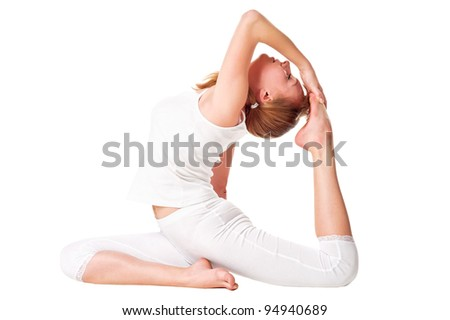 Young woman doing yoga exercise. Isolated over white - stock photo