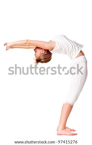 Young woman doing yoga exercise. Isolated over white
