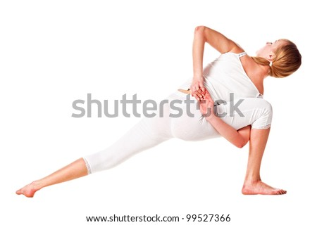 Young woman doing yoga exercise. Rear view. Isolated over white - stock photo