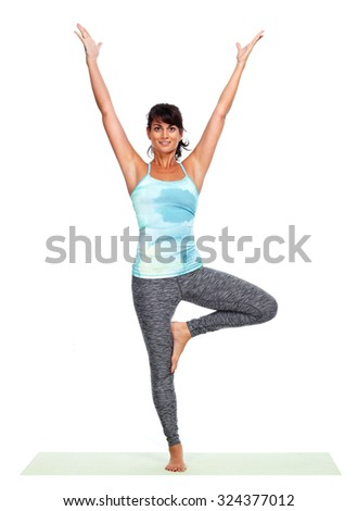 Young woman doing yoga isolated over white background. - stock photo