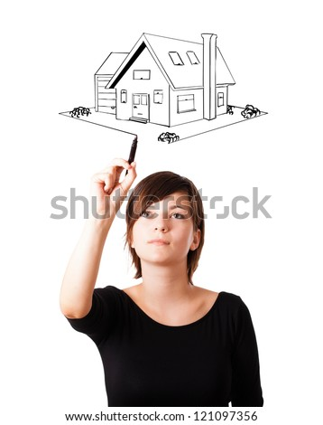 Young woman drawing a house on whiteboard isolated on white