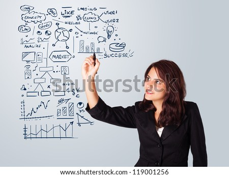 Young woman drawing business scheme and icons on whiteboard