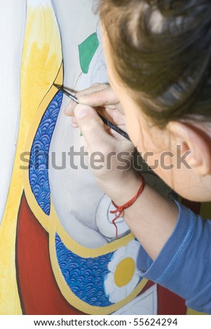Young woman drawing in pencil in drawing school - stock photo