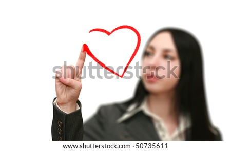 young woman draws a heart shape - stock photo