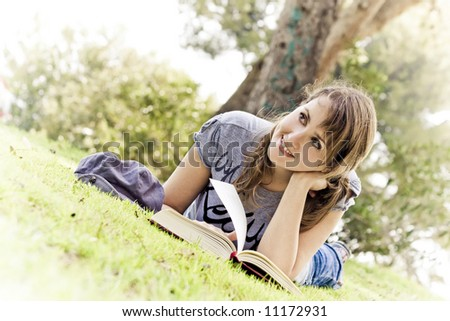 Young woman dreaming with stories and books - stock photo