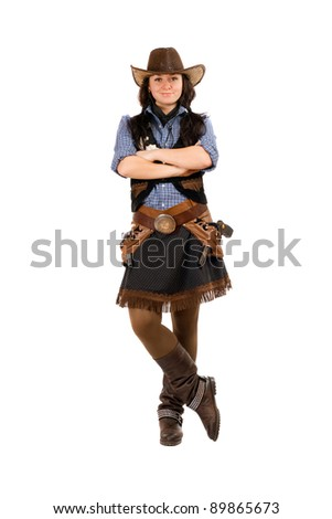 Young woman dressed as a cowboy. Isolated