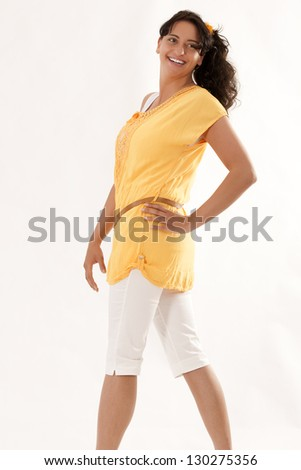 Young woman dressed fashionably and laughing / There's Something About Color - stock photo