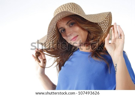 young woman dressed in blue with white hat on