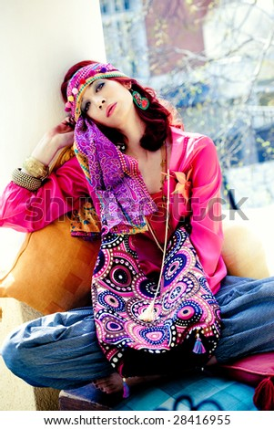 young woman dressed in colorful summer clothes with lot of accessories - stock photo