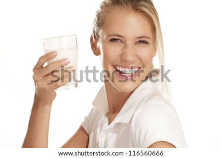 young woman drink milk on white background - stock photo
