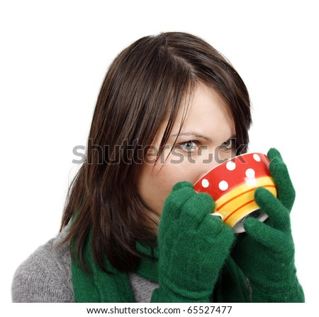 Young woman drinking a hot beverage - stock photo