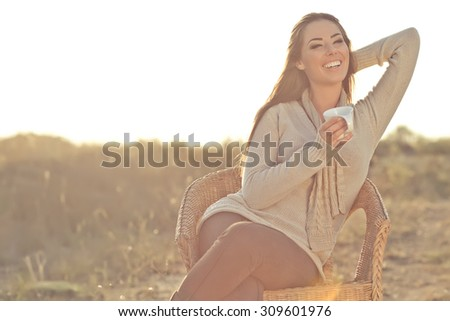 Young woman drinking coffee  - stock photo