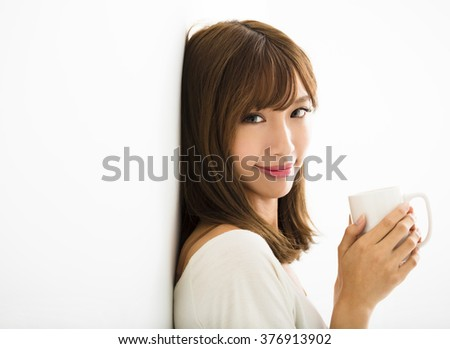 young Woman drinking hot latte coffee in living room