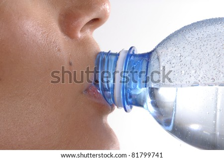 Young woman drinking mineral water bottle, - stock photo