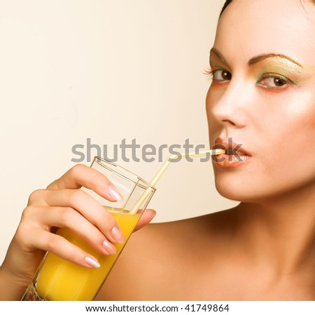 young woman drinking orange juice close up - stock photo