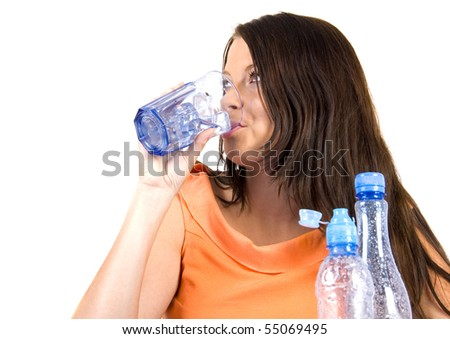 Young woman drinking spring water