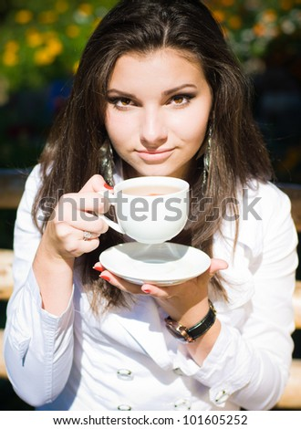 Young woman drinking tea - stock photo