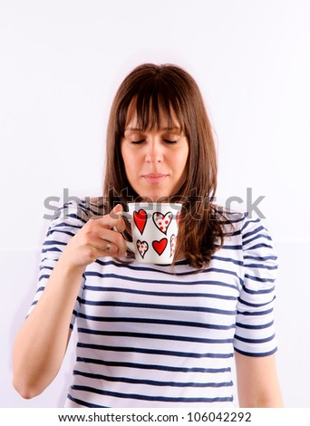 Young woman drinking the coffee