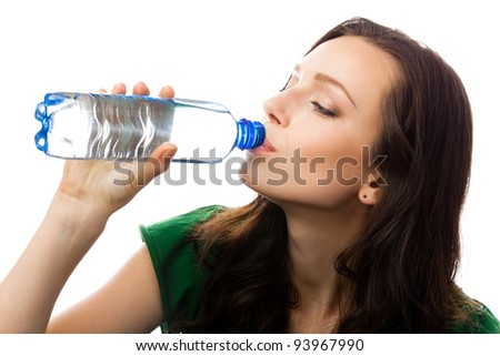 Young woman drinking water from bottle, isolated over white background