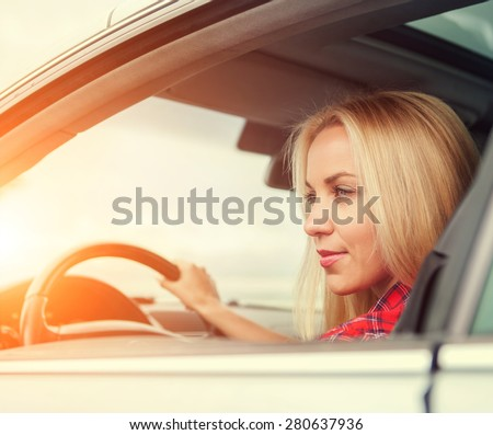 Young woman drive a car - stock photo