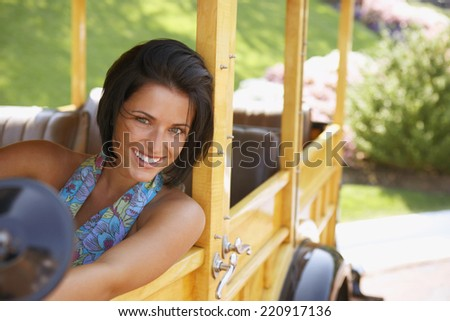 Young woman driving old fashioned car - stock photo