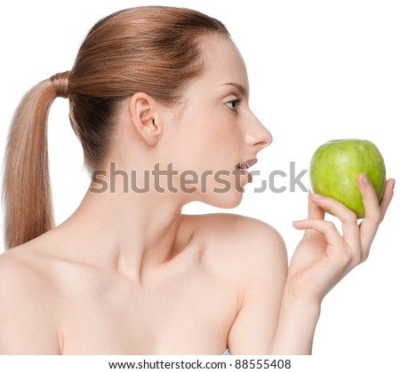 Young woman eat green apple